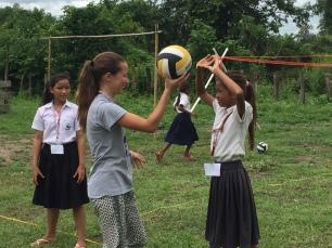 Anna teaching volleyball. By Ann Marie