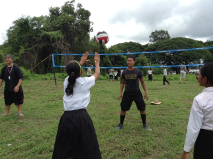 Joshua and Christian teaching the village children how to play volleyball. By Josh Kila